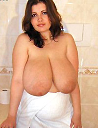 After the shower her huge breasts hang out dripping with water and milk